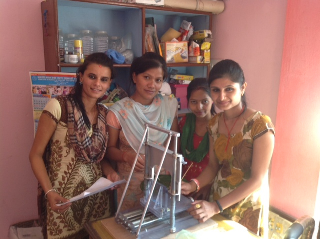 Women of the Sumunnat Project with the Simmons Slicer.