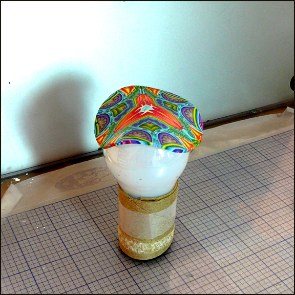 clay placed on light bulb 8in